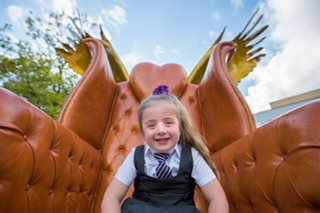 school girl sitting on one of the Kirkby Thrones