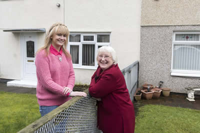 Elizabeth Greenall, last year's Good Neighbours in Knowsley winner, with her neighbour Joanne McCullock