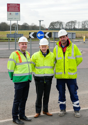 Sean Traynor, Head of Highways at Knowsley Council, Cllr Mike Murphy, Knowsley's Cabinet Member for Regeneration and Economic Development and Jon Collins, Site Agent at Dowhigh at the new junction.
