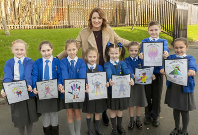Cllr Steff O'Keeffe with children from Kirkby C of E Primary school who took part in the fostering themed art and writing competition
